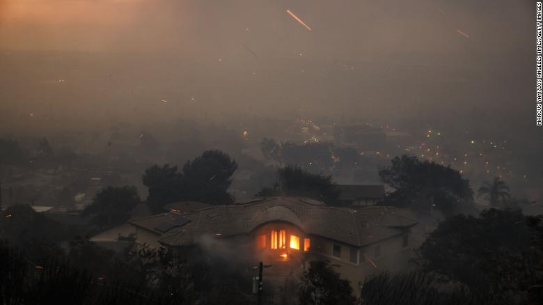 A home burns on a hillside overlooking Ventura, California.