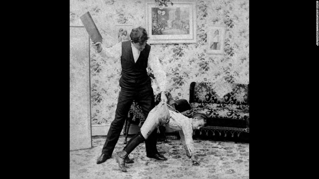 "The tools of spanking are varied. In this vintage image, a man uses a paddle. For adults administering punishment,<strong> </strong>the use of switches, belt straps, paddles and the like delivered increased punishment while saving their hands from the sting of the swat. <br />In the slave trade, there was a crueler reason for the use of a paddle or strap. In his book ""<a href=""https://books.google.com/books?id=R-BAAAAAcAAJ&printsec=frontcover&pg=PA304#v=onepage&q&f=false"" target=""_blank"">Flagellation and the Flagellants: A History of the Rod in all Countries from the Earliest Period to the Present Time</a>,"" the Rev. William Cooper explains that straps were used to keep from scarring slaves and reducing their value: ""It is said that with this instrument a slave could be punished to within an inch of his life, and yet come out with no visible injury, and with his skin as smooth as a peeled onion."""