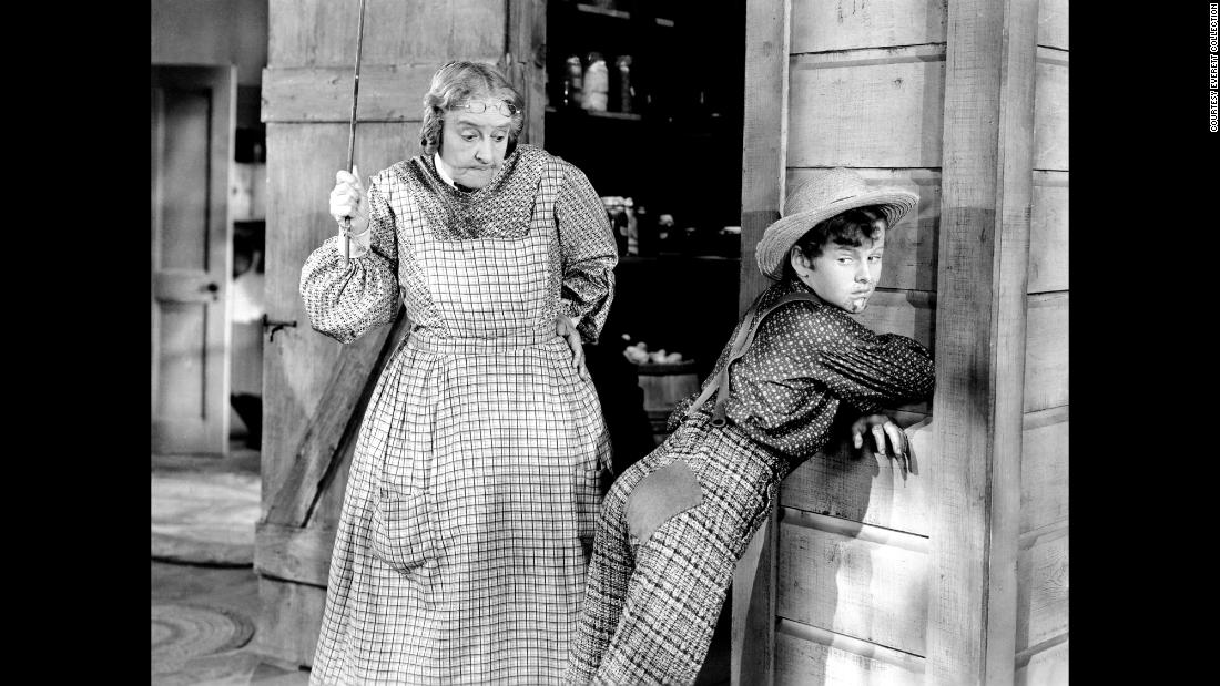 "Spanking was a common theme in pop culture. In Mark Twain's classic ""The Adventures of Tom Sawyer,"" Aunt Polly, played in the 1938 movie by May Robson, frequently punishes Tom, played by Tommy Kelly, for playing hooky and other mischief."