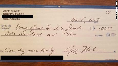 GOP Sen. Jeff Flake writes check to Democrat opposing Roy Moore