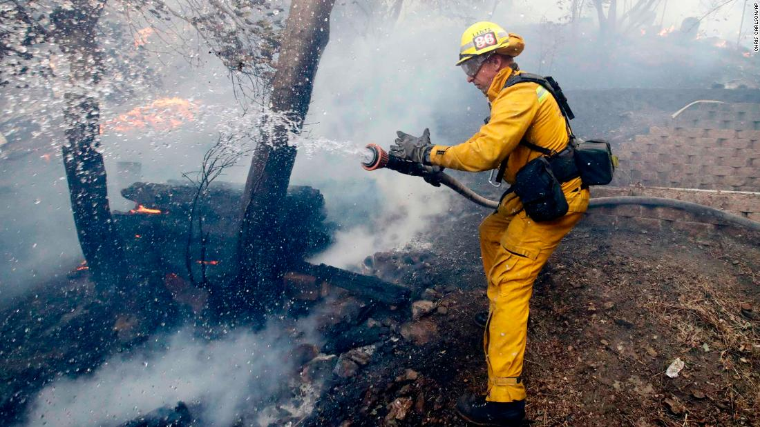 A firefighter battles a blaze in the Lake View Terrace area of Los Angeles on December 5.