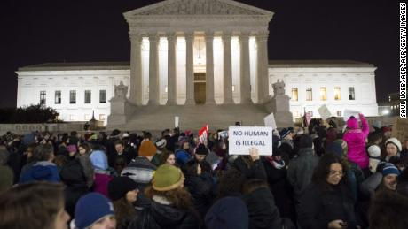 (FILES) This file photo taken on January 30, 2017 shows a protest outside the US Supreme Court in Washington, DC, against US President Donald Trump and his administration's travel ban.  The US Supreme Court said on December 4, 2017, that the government could fully enforce a ban on travelers from six mainly Muslim countries pending appeal, backing Trump in the year-long battle over the controversial measure. The court stayed a lower court's October ruling that had blocked implementation of the ban on visitors from Chad, Syria, Yemen, Iran, Somalia and Libya, as a legal challenge to it continues in federal appeals court.  / AFP PHOTO / SAUL LOEBSAUL LOEB/AFP/Getty Images