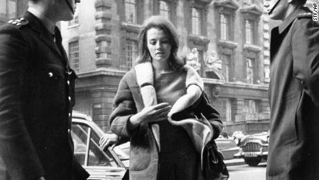 In this file photo dated April 1, 1963, Christine Keeler, 21, arrives at the Old Bailey in London, where her bail was forfeited for her failure to appear earlier as a court witness in a shooting case against her ex-lover.