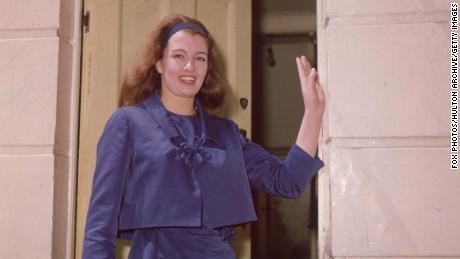 Christine Keeler stands outside her home in Linhope Street, north west London, shortly after her release from prison on June 9, 1964.