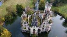 A picture taken on November 3, 2017 shows an aerial view of the ruined castle of La Mothe-Chandeniers, in Les Trois-Moutiers, central western France. Specialized in the rescue of old stones, the crowdfunding site Dartagnans.fr and the association Adopte un chateau launched at the end of October the collective takeover, via internet and by mutual agreement, of the ruined castle of La Mothe-Chandeniers ruins, for 500,000 euros. / AFP PHOTO / GUILLAUME SOUVANT        (Photo credit should read GUILLAUME SOUVANT/AFP/Getty Images)