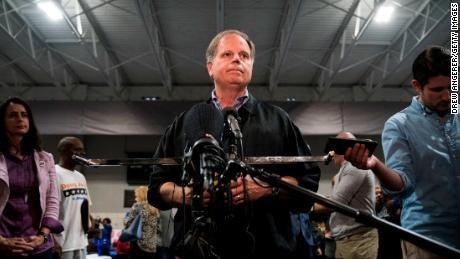 BIRMINGHAM, AL - NOVEMBER 18: Democratic candidate for U.S. Senate Doug Jones takes questions from reporters at a fish fry campaign event at Ensley Park, November 18, 2017 in Birmingham, Alabama. Jones has moved ahead in the polls of his Republican opponent Roy Moore, whose campaign has been rocked by multiple allegations of sexual misconduct. (Photo by Drew Angerer/Getty Images)