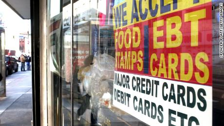 NEW YORK - OCTOBER 07: A sign in a market window advertises the acceptance of food stamps on October 7, 2010 in New York City. New York Mayor Michael Bloomberg is proposing an initiative that would prohibit New York City's 1.7 million food stamp recipients from using the stamps, a subsidy for poor residents, to buy soda or other sugary drinks. Bloomberg has stressed that obesity among the poor has reached critical levels. (Photo by Spencer Platt/Getty Images)