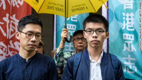 Bailed democracy activists Joshua Wong (R) and Nathan Law arrive at the Court of Final Appeal for the first hearing in their bid to appeal their jail sentences in Hong Kong on November 7, 2017. / AFP PHOTO / ANTHONY WALLACE        (Photo credit should read ANTHONY WALLACE/AFP/Getty Images)