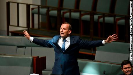 Former Australian Prime Minister Tony Abbott discusses amendments to the marriage equality bill at Parliament House on Thursday.