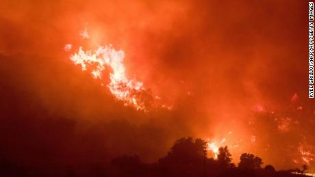 Thomas Fire burns a hillside in Ojai, California, December 7, 2017. Local emergency officials warned of powerful winds on Thursday that will feed wildfires raging in Los Angeles, threatening multi-million dollar mansions with blazes that have already forced more than 200,000 people to flee. / AFP PHOTO / Kyle GrillotKYLE GRILLOT/AFP/Getty Images