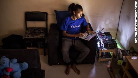 FILE: Eugene Mutai, a bitcoin 'miner' and software developer, poses for a photograph with cryptocurrency 'mining' machines at his home in Nairobi, Kenya, on Saturday, Sept. 9, 2017. Bitcoin is showing no signs of slowing down, the price of the largest cryptocurrency by market value is soaring as it gains greater mainstream attention despite warnings of a bubble in what not everyone agrees is an asset. Our editors select the best archive images on Bitcoin. Photographer: Luis Tato/Bloomberg via Getty Images