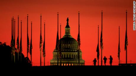 The U.S. Capitol dome backdrops a column of American flags standing at half-staff as the sun rises on Tuesday, Oct. 3, 2017, at the foot of the Washington Monument on the National Mall in Washington. President Donald Trump ordered flags to be flown at half-staff at the White House and upon all public buildings and grounds, at all military posts and naval stations, and on all naval vessels of the Federal Government in the District of Columbia and throughout the United States and its Territories and possessions until sunset on October 6, 2017, to pay respect for the victims of the shooting at a country music concert Sunday night in Las Vegas. (AP Photo/Manuel Balce Ceneta)