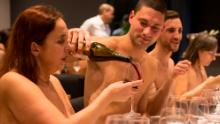 "EDITORS NOTE: Graphic content / A nude diner fills wine for another at the newly opened nudist restaurant ""o'naturel"" in Paris on December 5, 2017.