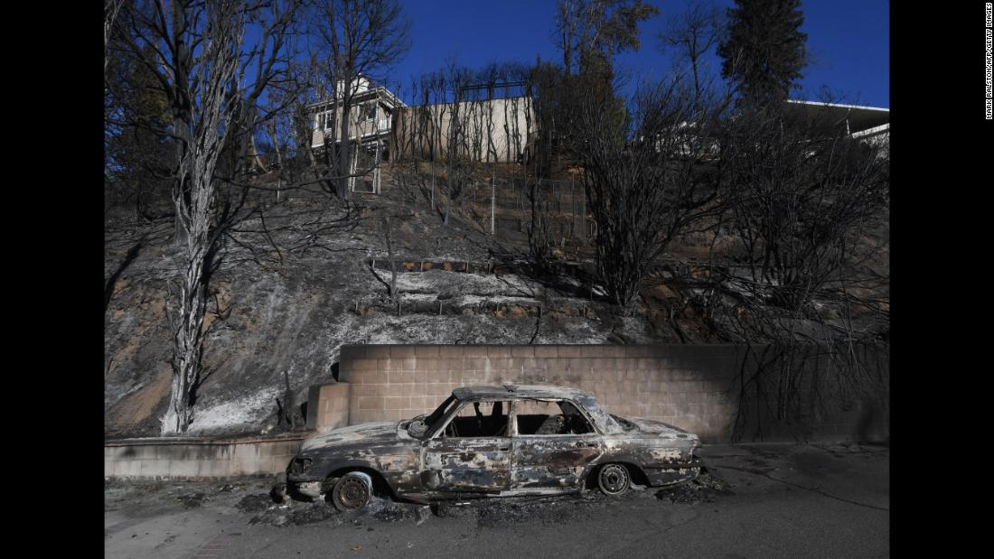 A burnt Mercedes is seen after the Skirball Fire swept through the Los Angeles neighborhood of Bel-Air on Thursday, December 7.