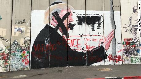 Bethlehems message to Pence, there is no room at the inn. Image is on the separation wall in Bethlehem.