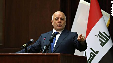 Iraq Prime Minister Haider al-Abadi  gestures, during a press conference, in Baghdad, Iraq, Saturday, Dec. 9, 2017. Iraq said Saturday that its war on the Islamic State is over after more than three years of combat operations drove the extremists from all of the territory they once held. al-Abadi announced Iraqi forces were in full control of the country's border with Syria during remarks at a conference in Baghdad, and his spokesman said the development marked the end of the military fight against IS. (AP Photo/Karim Kadim)
