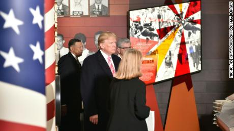 U.S. President Donald Trump visits the Civil Rights Museum in Jackson, Mississippi, December 9, 2017.  The Mississippi Civil Rights Museum is a museum in Jackson, Mississippi with the mission  to document, exhibit the history of, and educate the public about the American Civil Rights Movement in the U.S. state of Mississippi between 1945 and 1970. / AFP PHOTO / Nicholas Kamm