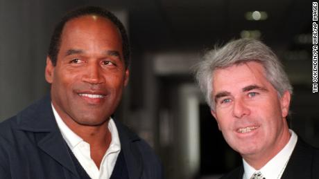 File photo dated 11/045/96 of Max Clifford (right) with OJ Simpson at Heathrow airport on his arrival to the United Kingdom. Publicist Max Clifford has died in hospital after collapsing at Littlehey Prison in Cambridgeshire, a spokeswoman for the Ministry of Justice has said. Issue date: Sunday December 10, 2017.