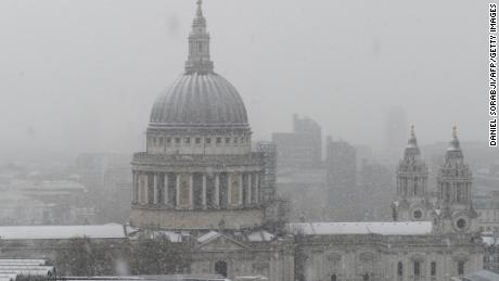 St Paul's Cathedral is seen as snow falls over central London on December 10, 2017.