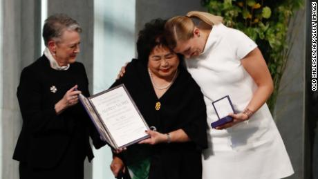 "Berit Reiss-Andersen (L), chairperson of the Norwegian Nobel Committee, hands over the 2017 Nobel Peace Prize to Beatrice Fihn (R), leader of ICAN (International Campaign to Abolish Nuclear Weapons), and Hiroshima nuclear bombing survivor Setsuko Thurlow (C) during the award ceremony of the 2017 Nobel Peace Prize at the city hall in Oslo, Norway, on December 10, 2017. The Nobel Peace Prize is awarded to the International Campaign to Abolish Nuclear Weapons (ICAN), as its representatives warn of ""an urgent threat"" over US-North Korea tensions."