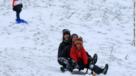 Families take to the hills with sledges near Edale in Derbyshire, northern England.