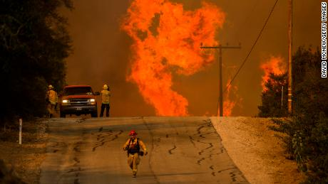 OJAI, CA - DECEMBER 08: Flames rise as a fire front approaches the Lake Casitas area on December 8, 2017 near Ojai, California. Strong Santa Ana winds have been feeding major wildfires all week, destroying hundreds of houses and forcing tens of thousands of people to stay away from their homes.  (Photo by David McNew/Getty Images)