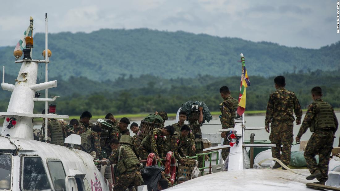 Myanmar soldiers arrive at Buthidaung jetty in Myanmar's Rakhine State on August 29, 2017.