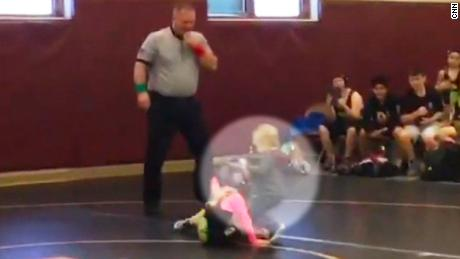 boy jumps in to rescue sister wrestling match video _00000929.jpg