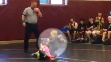 Little boy jumps into sister's wrestling match
