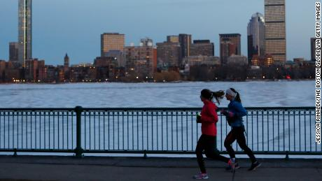 [CAMBRIDGE, MA - MARCH 5: Runners jog past an icy Charles River in Cambridge, Mass. on March 6, 2014.(Photo by Jessica Rinaldi/The Boston Globe via Getty Images)
