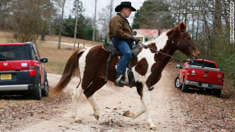 Roy Moore rides a horse to vote on December 12, 2017, in Gallant, Alabama.