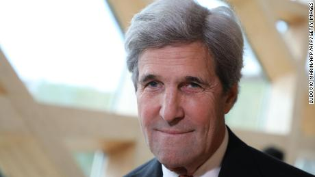 "Former US secretary of state John Kerry smiles during the One Planet Summit on December 12, 2017 at La Seine Musicale venue on l'ile Seguin in Boulogne-Billancourt, west of Paris. ?The French President hosts 50 world leaders for the ""One Planet Summit"", hoping to jump-start the transition to a greener economy two years after the historic Paris agreement to limit climate change. / AFP PHOTO / LUDOVIC MARIN        (Photo credit should read LUDOVIC MARIN/AFP/Getty Images)"