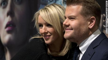 "British actor James Corden (R) and his wife Julia Carey pose for photographers as they arrive for the UK Gala Screening of ""Into The Woods"" in central London on January 7, 2015. AFP PHOTO / JUSTIN TALLIS        (Photo credit should read JUSTIN TALLIS/AFP/Getty Images)"
