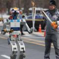 01 robot carries olympic torch 1211