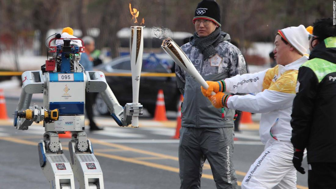 While the Olympics have traditionally been the realm of human competition, it appears robots are coming for next year's Games in South Korea. A humanoid bot, dubbed HUBO, received the iconic flame from Dr Dennis Hong in Daejeon on Monday 11 December 2017.