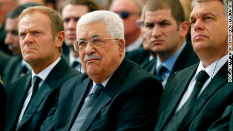 JERUSALEM, ISRAEL - SEPTEMBER 30:   Palestinian President Mahmoud Abbas (C) sits alongside European Council President Donald Tusk (L) and President of Romania is Klaus Iohannis (R) as they attend the funeral of Shimon Peres at Mount Herzl Cemetery on September 30, 2016 in Jerusalem, Israel. World leaders and dignitaries from 70 countries attended tthe state funeral of Israel's ninth president, Shimon Peres, in Jerusalem on Friday, after thousands of Israelis paid their last respects to the elder statesman who died on Wednesday. (Photo by Abir Sultan- Pool/Getty Images)
