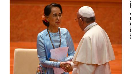Pope Francis (R) shakes hands with Myanmar's Aung San Suu Kyi during an event in Naypyidaw.
