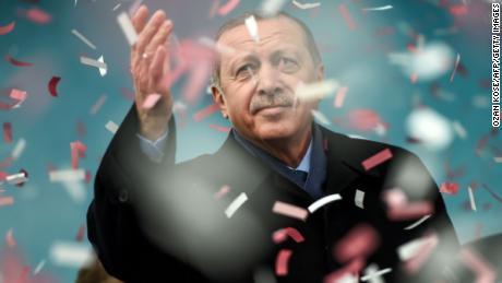 Turkish President Recep Tayyip Erdogan gestures amid confetti during a rally in Istanbul.