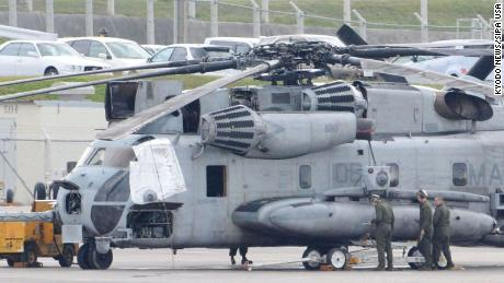 A US military CH-53E transport helicopter, with one of the windows (left) covered, is parked at the US Marine Corps Air Station Futenma in Ginowan, Okinawa, on December 13.