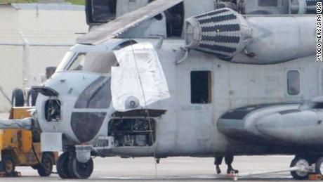 Photo shows a US military CH-53E transport helicopter, with one of the windows (left) covered, parked at the US Marine Corps Air Station Futenma in Ginowan, Okinawa Prefecture, Japan, on December 13.