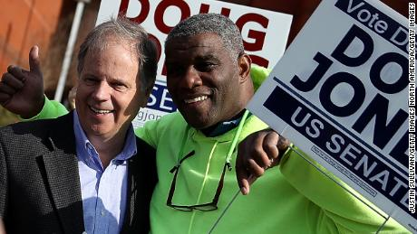 BESSEMER, AL - DECEMBER 12:  Democratic senatorial candidate Doug Jones takes a picture with voters outside of a polling station at the Bessemer Civic Center on December 12, 2017 in Bessemer, Alabama. Doug Jones is facing off against Republican Roy Moore in a special election for U.S. Senate.  (Photo by Justin Sullivan/Getty Images)