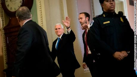 WASHINGTON, DC - DECEMBER 5: Vice President Mike Pence waves as he leave a meeting with Senate Republicans on Capitol Hill, December 5, 2017 in Washington, DC. After the Senate passed their tax reform legislation last week, the next step will be a conference committee with members of the House to iron out the differences between the two bills. (Drew Angerer/Getty Images)