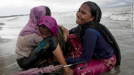 DAKHINPARA, BANGLADESH - SEPTEMBER 12:  Rohingya refugee woman break down in tears after jumping from a wooden boat that began to tip over as it hit the shore on September 12, 2017 in Dakhinpara, Bangladesh. Recent reports have suggested that around 290,000 Rohingya have now fled Myanmar after violence erupted in Rakhine state. The 'Muslim insurgents of the Arakan Rohingya Salvation Army' have issued statement that indicates that they are to observe a cease fire, and have asked the Myanmar government to reciprocate.  (Photo by Dan Kitwood/Getty Images)