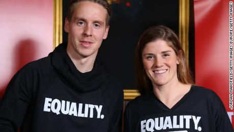 LONDON, ENGLAND - DECEMBER 13:  Stefan Johansen (L) and Maren Mjelde (R) pose for a photo during the Football Association of Norway National Team Equal Pay Agreement Announcement at the Norwegian Ambassador's Residence on December 13, 2017 in London, England.  (Photo by Jordan Mansfield/Getty Images)