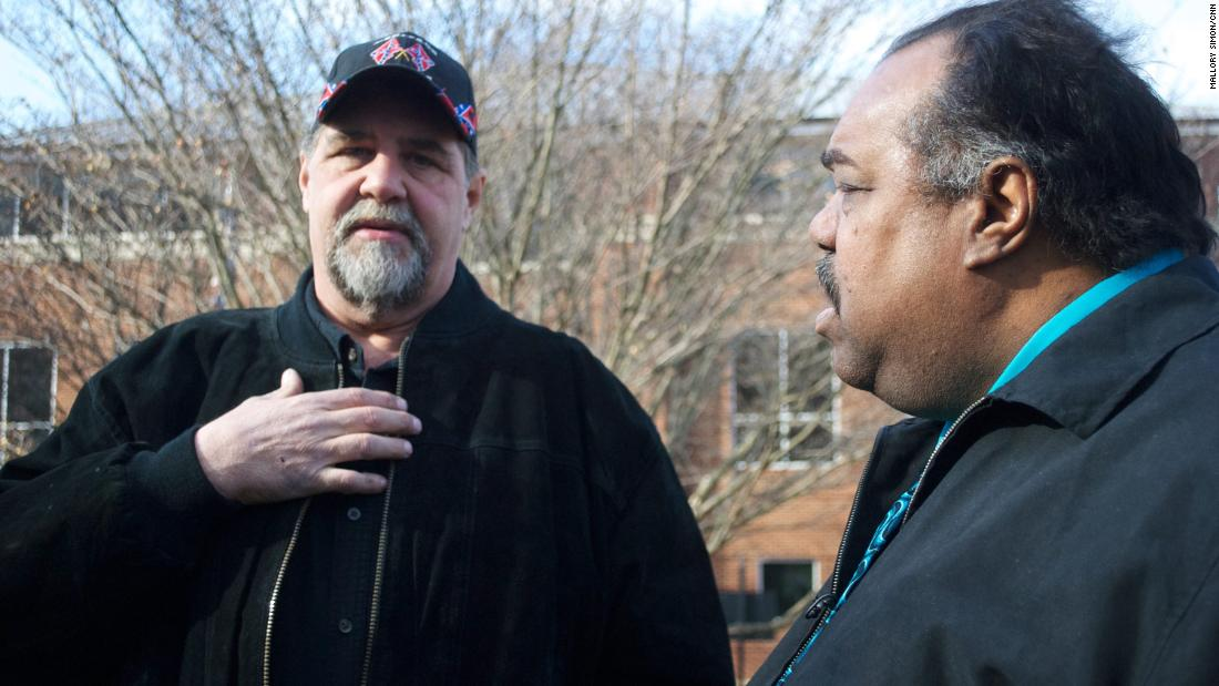 Imperial Wizard Billy Snuffer of the Rebel Brigade Knights, left, discusses the Klan, Nazis and hate with Daryl Davis.