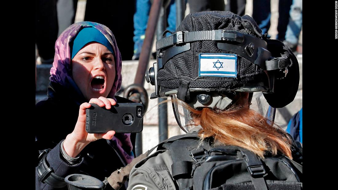 "A Palestinian protester points her phone at an Israeli soldier Friday, December 8, by the Damascus Gate entrance to Jerusalem's Old City. Following US President Donald Trump's decision to recognize Jerusalem as the capital of Israel, <a href=""http://www.cnn.com/2017/12/08/middleeast/jerusalem-trump-friday-prayers-protests-intl/index.html"" target=""_blank"">brief scuffles broke out</a> by the Damascus Gate, where protesters chanted slogans and held Palestinian flags aloft. Protesters and Israeli forces also clashed in Gaza and the West Bank."