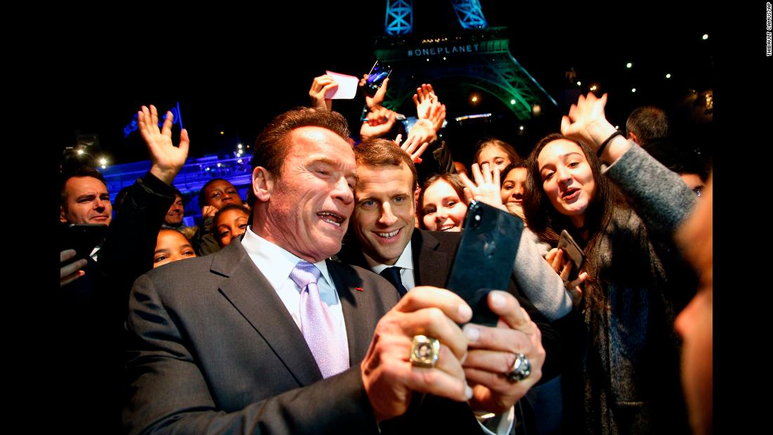 "Actor Arnold Schwarzenegger takes a selfie with French President Emmanuel Macron as their boat cruises past the Eiffel Tower in Paris on Tuesday, December 12. They were coming back from the <a href=""http://www.cnn.com/2017/12/12/europe/macron-paris-climate-change-intl/index.html"" target=""_blank"">One Planet Summit,</a> where world leaders gathered to show their commitment to the 2015 Paris Agreement on climate change."