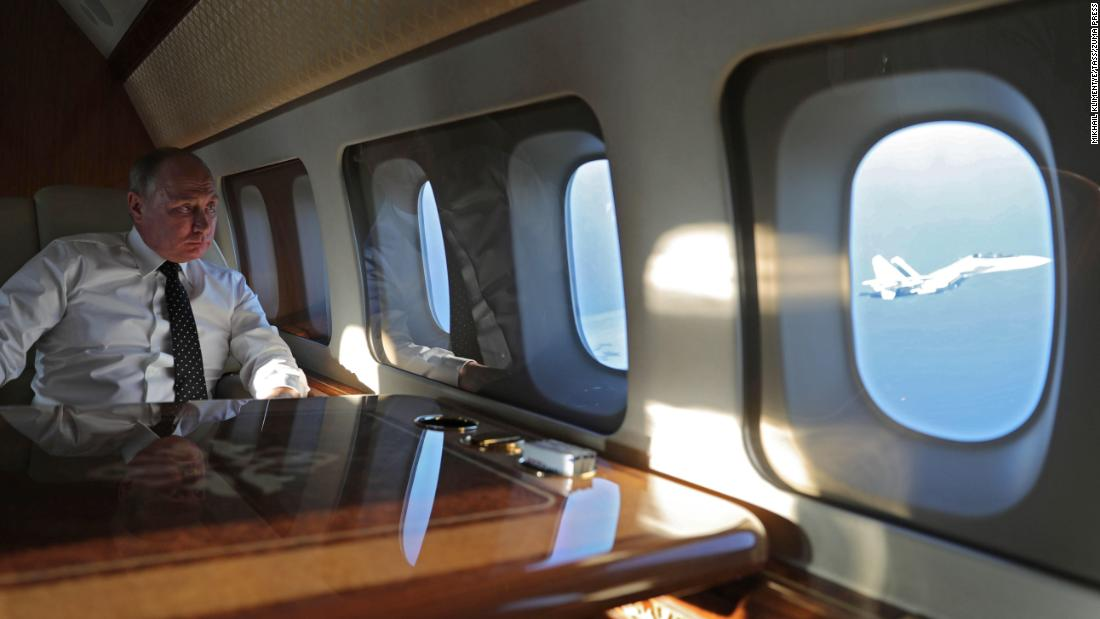 "Russian President Vladimir Putin looks out of his plane as he travels to a Russian airbase in Syria on Monday, December 11. During his visit, Putin <a href=""http://www.cnn.com/2017/12/11/middleeast/putin-russia-syria-withdrawal/index.html"" target=""_blank"">ordered a partial withdrawal</a> of Russian troops from Syria. ""If terrorists will raise their heads ever again, we will strike them with such force that they have never seen before,"" Putin said in remarks that were broadcast on the state-owned Russia 24 news channel."
