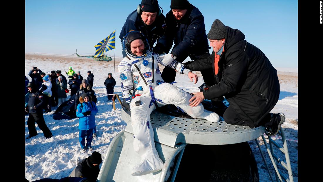 Russian cosmonaut Sergey Ryazansky is helped out of a space capsule after landing in Zhezkazgan, Kazakhstan, on Thursday, December 14. He and two others landed back on Earth after spending nearly six months aboard the International Space Station.