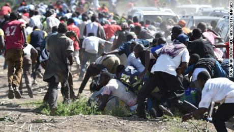 TOPSHOT - Supporters the opposition run away from teargas on November 28, 2017 during demonstrations at Umoja suburb of capital Nairobi, after police denied permission for main opposition, National Super Alliance (NASA) leader to hold a rally concurrently with the inauguration of Kenyan President. President Uhuru Kenyatta vowed to be the leader of all Kenyans and work to unite the country after a bruising and drawn out election process that ended with his swearing-in. / AFP PHOTO / TONY KARUMBA